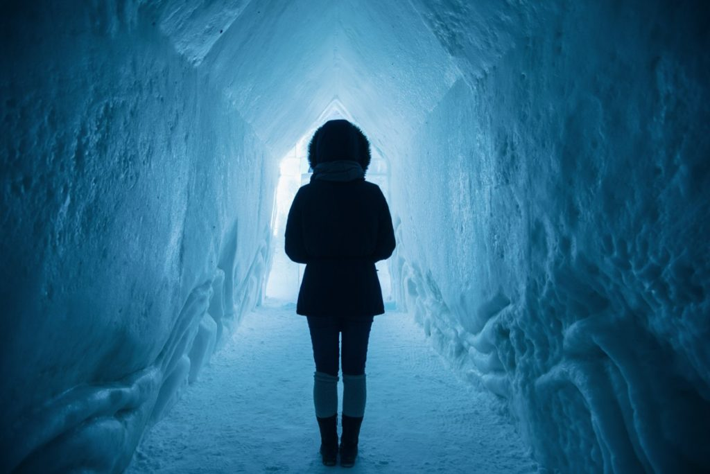 Adventure Girl in Blue Ice Cave