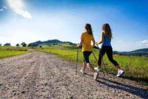 two girls nordic walking for exercise