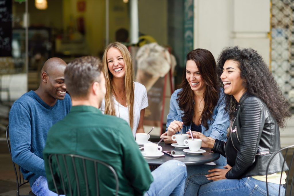 group of five friends having a coffee together