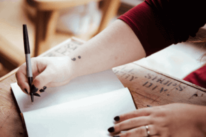 student using pen for writing in diary