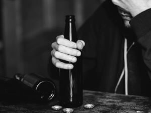 man with depression drinking alcohol