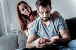 wife supporting husband with drug addiction
